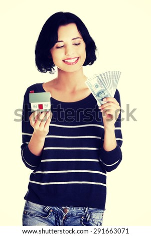 Young smiling woman holding dollars - stock photo