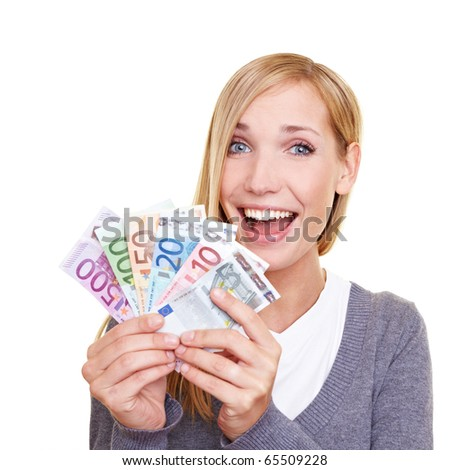 Young smiling woman holding fan made of Euro money - stock photo