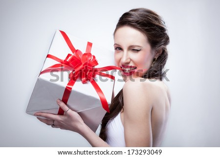 Young smiling woman holding gift