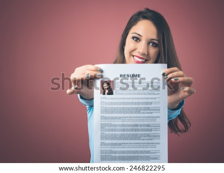 Young smiling woman holding her resume and applying for a job - stock photo