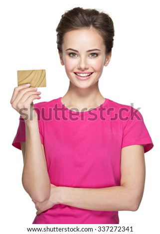 Young smiling woman holds credit card isolated on white - stock photo