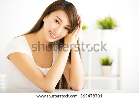 young smiling woman  in living room - stock photo