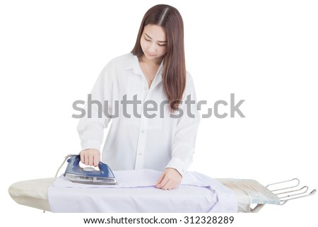 Young smiling woman is ironing a shirt with a  iron isolated on white background. - stock photo