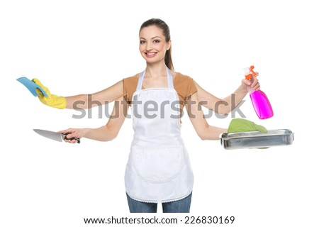 Young smiling woman isolated over white background. waist up of beautiful brunette with four hands and cleaning tools - stock photo