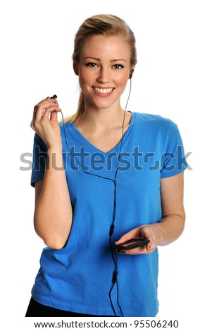 Young smiling woman listening to music on headphones. - stock photo