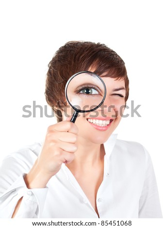 young smiling woman looking through magnifying glass isolated over white background