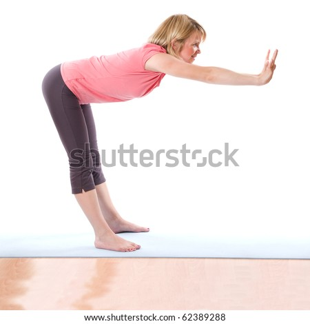 Young smiling woman making fitness indoor - stock photo