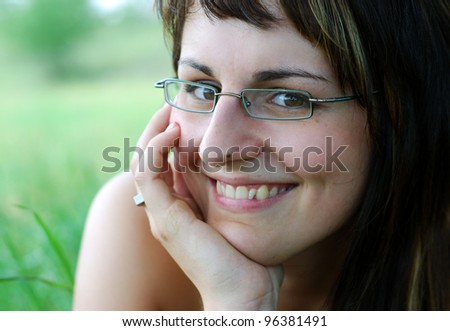 young smiling woman on a meadow in summer