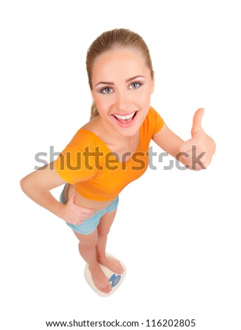Young smiling woman on scales isolated - stock photo