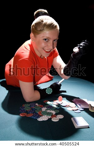 Young smiling woman on the poker table - stock photo