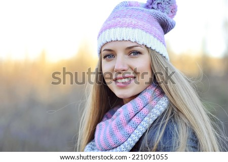 Young smiling woman outdoors portrait - stock photo