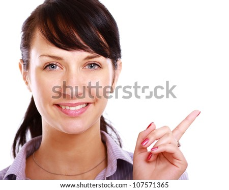 Young smiling woman points a hand, isolated on white background