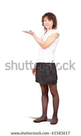 Young smiling woman points a hand over white - stock photo