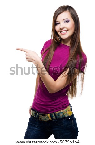 Young smiling woman points a hand with positive facial expression - isolated on white - stock photo