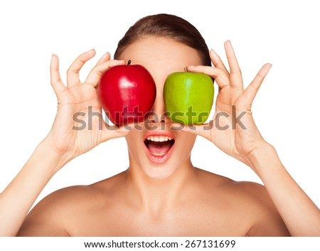 Young smiling woman posing with apples - stock photo