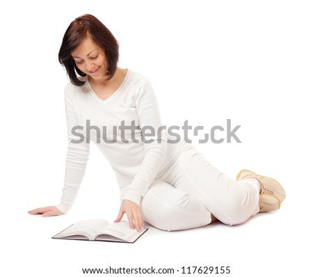 Young smiling woman reading book isolated - stock photo