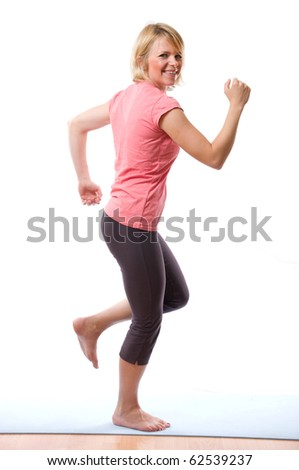 young smiling woman running on white - stock photo