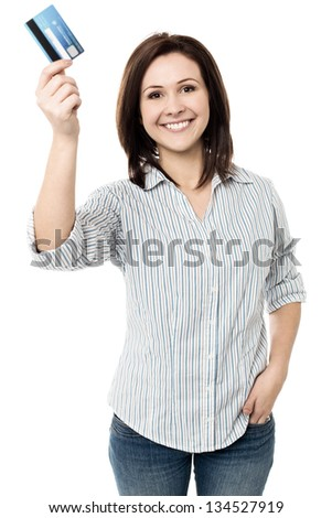 Young smiling woman showing her credit card to the camera. - stock photo
