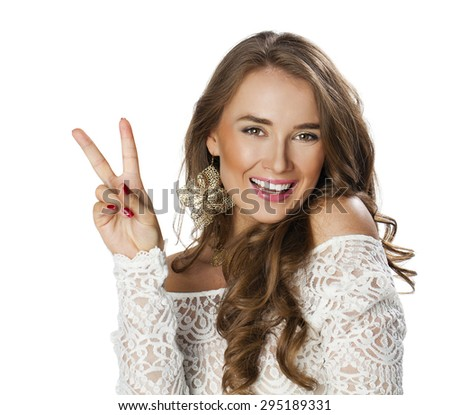 Young smiling woman showing victory or peace sign, isolated on white background  - stock photo