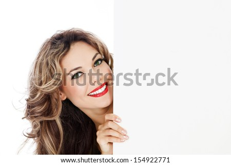 Young smiling woman shows blank card. - stock photo