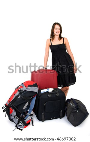 Young smiling woman surrounded by luggage being a happy traveler - stock photo