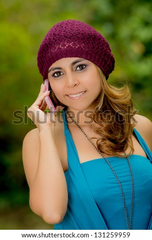 Young smiling woman talking phone calling - stock photo