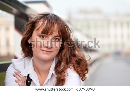 Young smiling  woman thinking about future