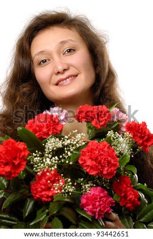 Young smiling woman with a bunch of red carnations in her hands - stock photo