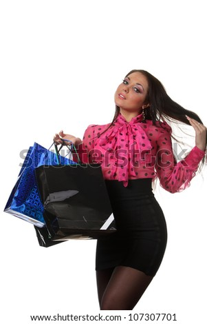 Young smiling woman with a shop bags