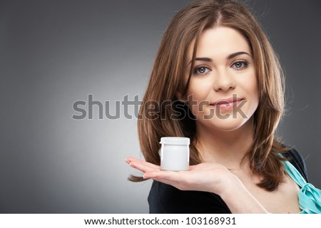 Young smiling woman with cream ( shampoo ), isolated on gray background - stock photo