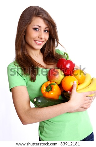 Young smiling woman with fruits and vegetables