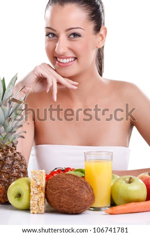 Young smiling woman with fruits and vegetables, over white background - stock photo