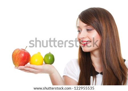 Young smiling woman with fruits and vegetables. Over white background - stock photo