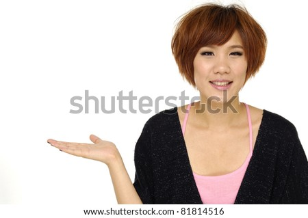 Young smiling woman with hand gesture and copy space - stock photo