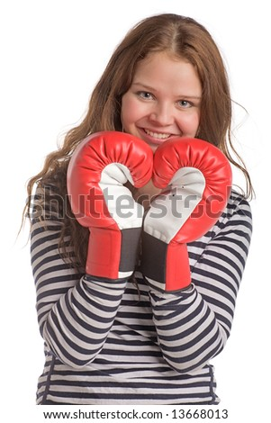 young smiling woman with hands in boxing gloves - stock photo