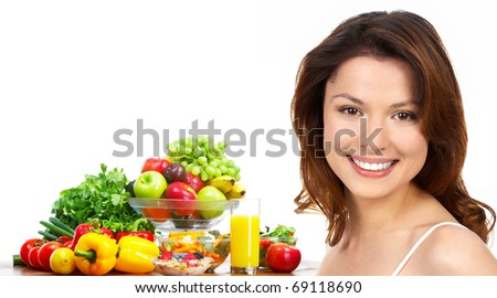 Young smiling woman  with juice, fruits and vegetables. Over white background