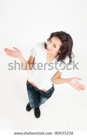 young smiling woman with no idea gesture - stock photo