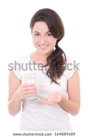 young smiling woman with pill and glass of water isolated on white background - stock photo