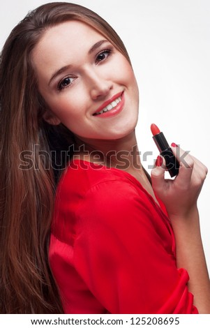 Young smiling woman with red lipstick on a light background - stock photo
