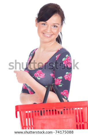 young smiling woman with red shopping basket - stock photo