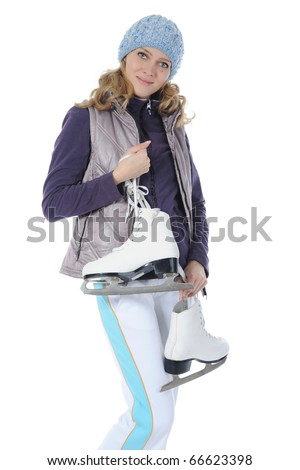 Young smiling woman with skates in studio. Isolated on white background - stock photo