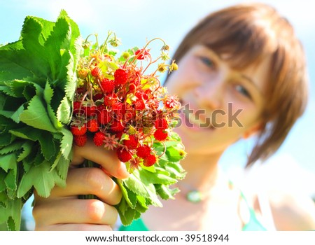 Young smiling woman with strawberry bouquet