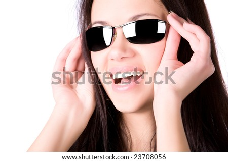 Young smiling woman with sunglasses. Isolated on white. - stock photo