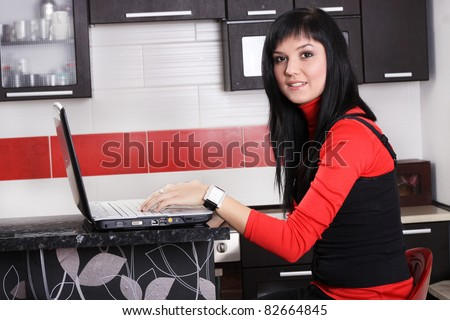 Young smiling woman working at home