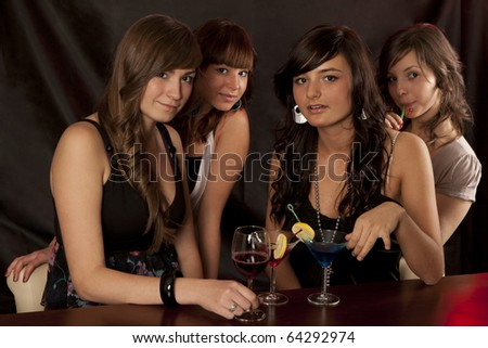 Young smiling women with color cocktail - stock photo