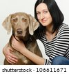 Young smiling women with dog - stock photo