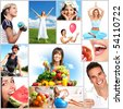 Young smiling women  with fruits and vegetables - stock photo
