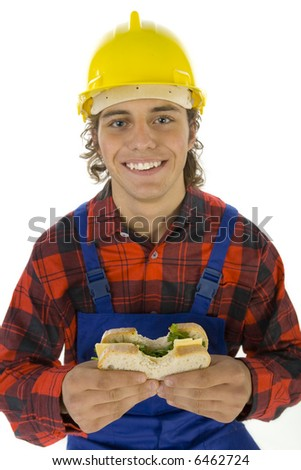 Young smiling worker eating lunch. He's looking at camera. White background - stock photo