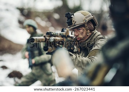 young sniper with guns - stock photo