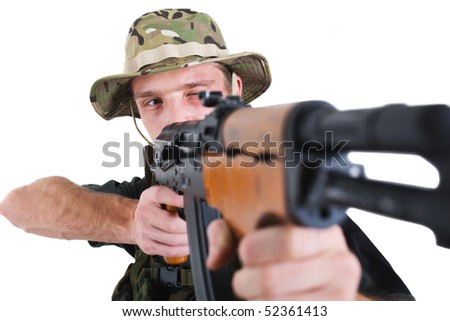 Young sniper with Kalashnikov assault rifle.